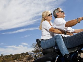 adult couple riding the motorcycle