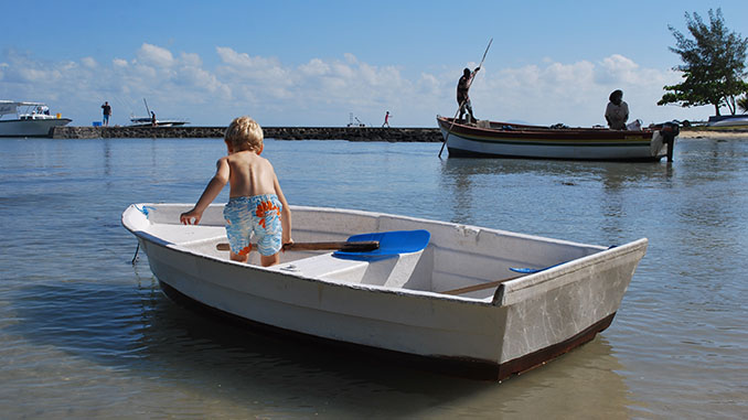 child on a small boat