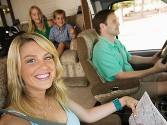 Family in rv on summer road trip
