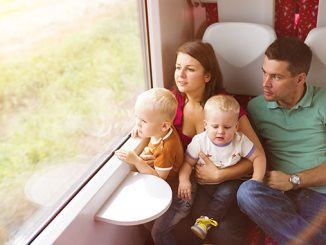 Family with two sons travel in train