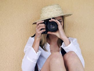 female photographer taking picture
