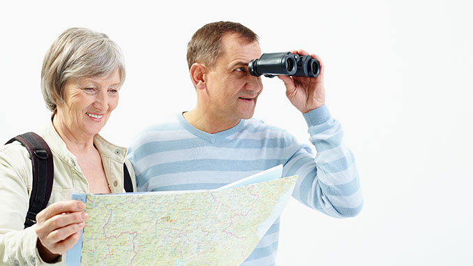 happy senior couple traveling
