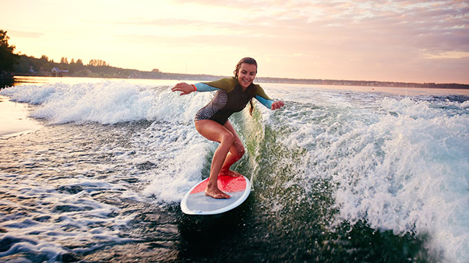 Young Woman Surfboarding
