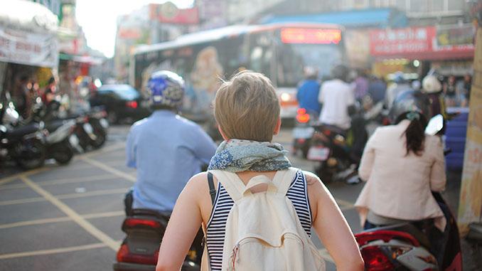 lone woman traveler city downtown