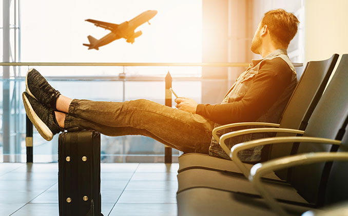 man sitting in an airport