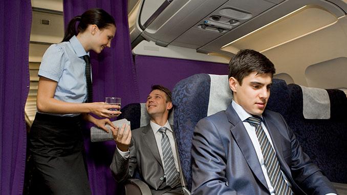 stewardess serving a passenger