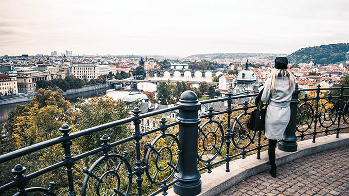 woman looking over the autumn prague