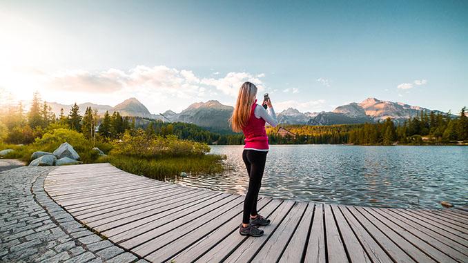 Woman Traveler Taking a Photo of High Tatras, Slovakia