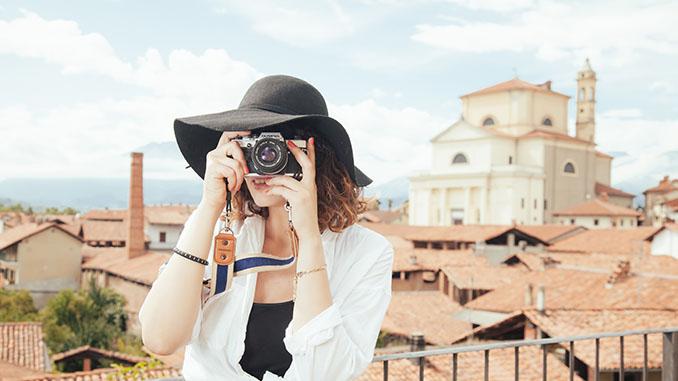 woman traveler taking photos