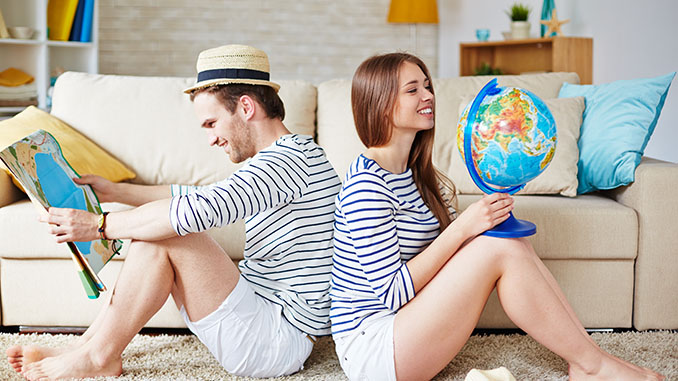 Young couple thinking of where to go traveling