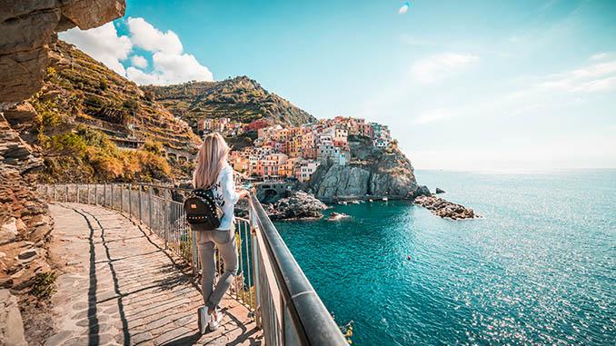 young woman traveler admiring manarola town