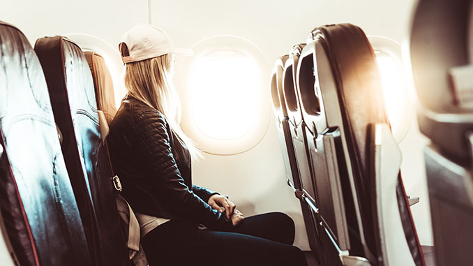 young woman traveling by airplane